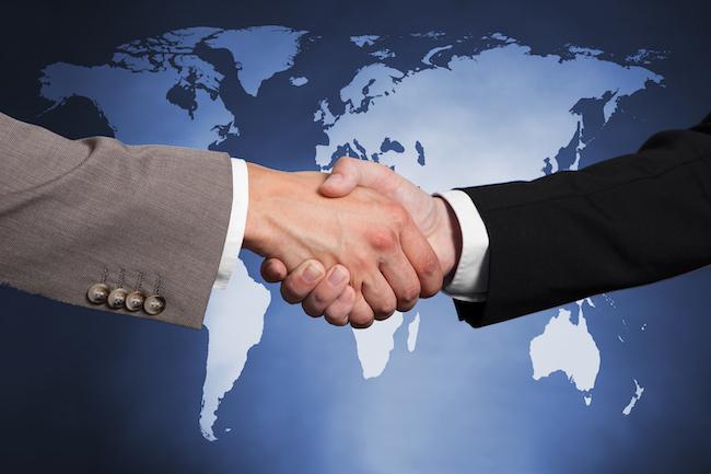 global-handshake-Andrey-Popov-Adobe-650 .jpg